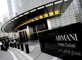Armani Hotel waiter pleads guilty to stealing from guests