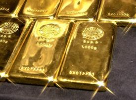 Gold prices slump to 19-month low