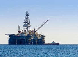 Oil falls below $58 as rig count counters OPEC curbs extension