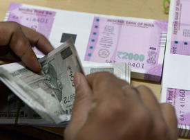 Indian rupee falls to new low against dollar