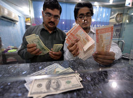 Pakistan's central bank devalues rupee as finances wobble before election