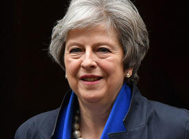 Theresa May plans UK property tax for foreign home buyers