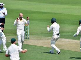 Lyon blitz restricts Pakistan on day one of Abu Dhabi Test