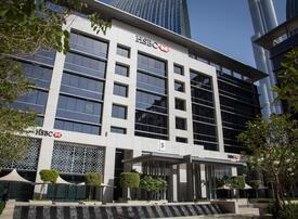 HSBC profits halved as coronavirus batters global economy