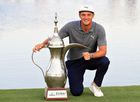 DeChambeau wins by seven shots to set records in Dubai