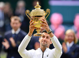 Gallery: Novak Djokovic claims his fifth Wimbledon title in record-breaking final against Roger Federer