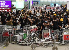 Hong Kong airport protesters retreat, but city in turmoil