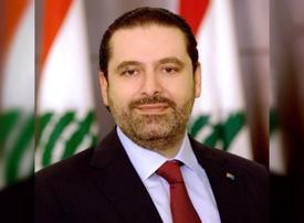 Lebanon's Hariri steps aside to speed up new govt