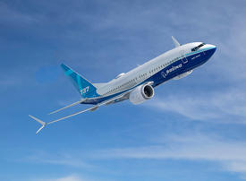 Boeing unveils new 737 MAX as grounding drags on