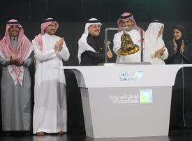 Saudi Aramco shares soar maximum 10% on market debut