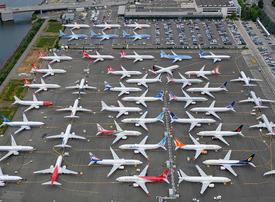 Boeing to halt production of embattled 737 Max jets