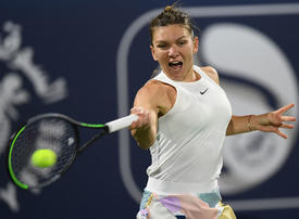 Halep downs battling Jabeur on fourth match point in Dubai