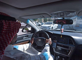 Saudi jobseekers move into Uber gear for extra cash