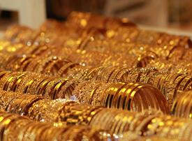 Gold bursts above $1,700 with market mayhem stoking haven demand