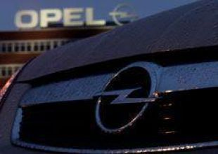 German minister may discuss Abu Dhabi stake in Opel