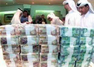 Qatar affirms single currency commitment