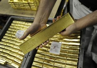 Gold nears record high, despite firm dollar
