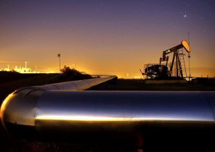 Oil climbs to two-year high, stocks gain on recovery confidence