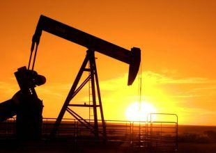 Oil trades near two-year high on bets weather will boost demand