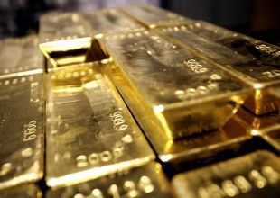 Gold hits record as debt, inflation fears spur demand