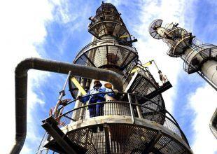 Oil rises on US spending, Greek bank merger