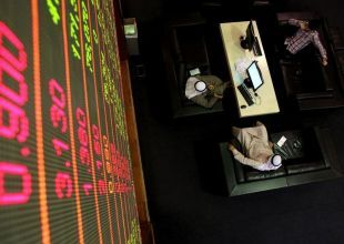 Saudi Arabia closes up, bouyed by earnings hopes