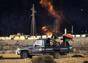 UN agrees military action on Libya, Gaddafi warns no mercy