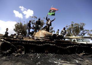 Libya warns against arming Gaddafi rebels