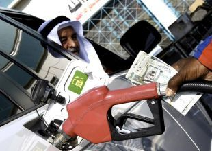 Oil prices fall on economic fears, dollar gains