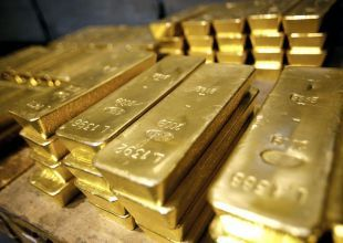 Gold jumps to record high as global equities suffer