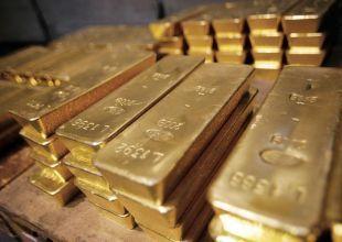 Gold rises on China PMI data; flirts with $1,600