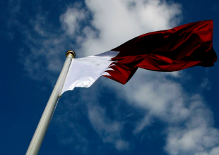 Qatar summons US envoy over video of soldiers laughing near flag
