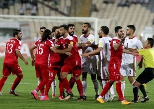 War-torn Syria keep historic football dream alive after draw with Iran