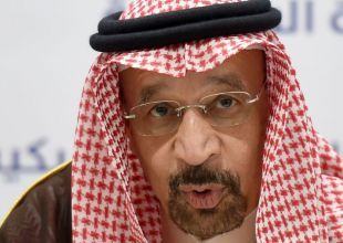Oil rises towards $65 on Saudi commitment to curb output, weak dollar
