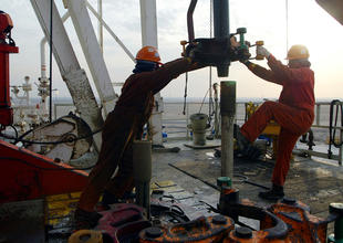 Global oil glut nearly over, says IEA