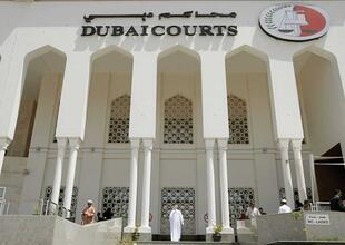 Dubai policeman pays fine to save woman from jail