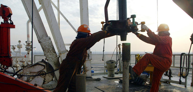 Oil holds near $42 while investors weigh demand against virus