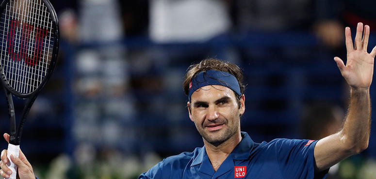 'On edge' Federer unsure of title century after moving into Dubai last eight