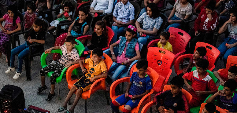 Gallery: Syrian kids enjoy movies through the outdoor mobile cinema