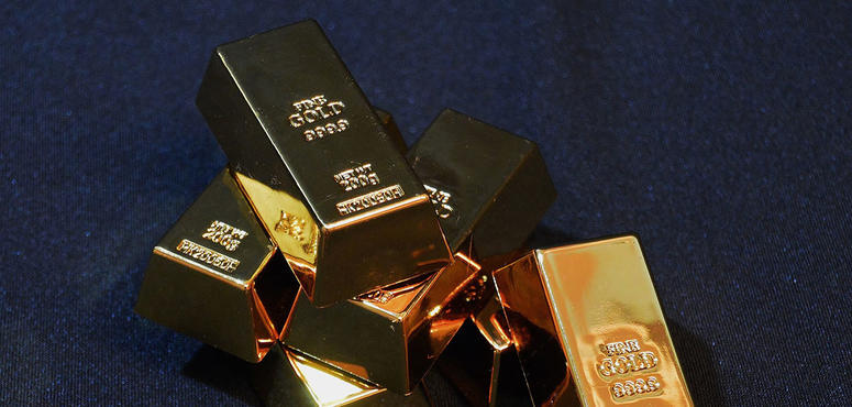 Gold showing resilience, likely to stay above $1,380, says Saxo Bank