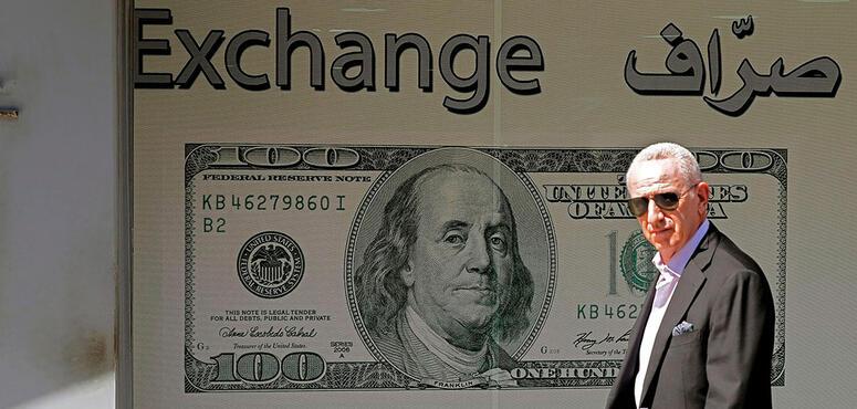 Lebanon banks halt dollar withdrawals after virus closes airport