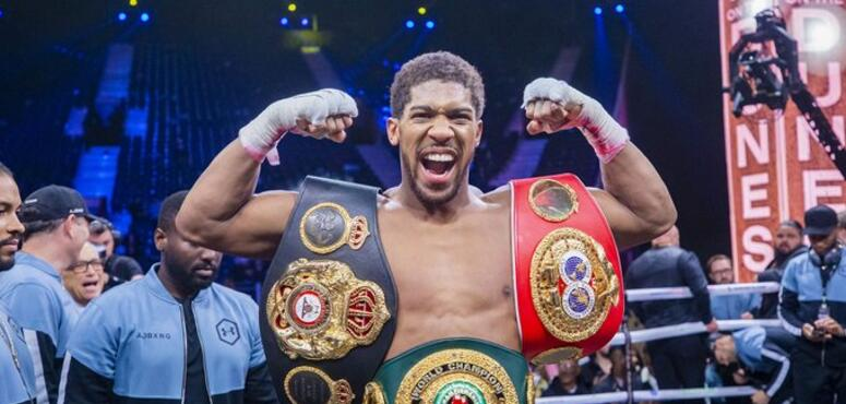 Joshua tightlipped on future after reclaiming world titles