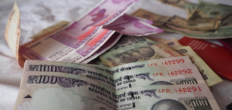 India's rupee reaches record low, past the key 75 mark