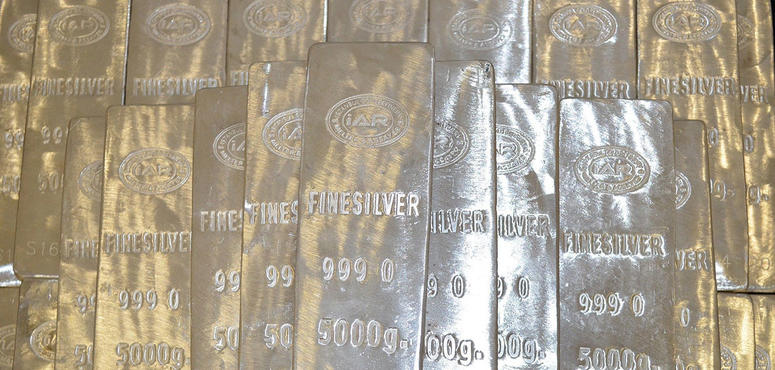 Silver jumps to seven-year high, gold near record in flight to havens
