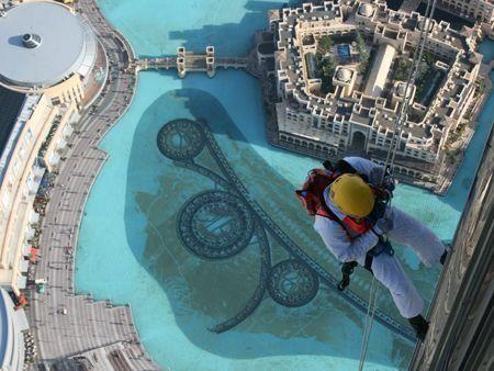 Abseilers fit Burj Khalifa fireworks