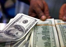 Oman to continue dollar peg, sees higher growth