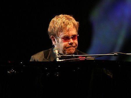 Elton John sues Dubai banker over charity date