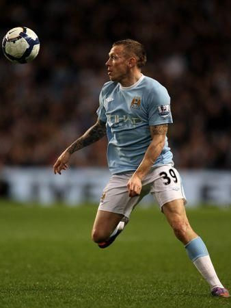 Tevez hat trick gives Man City win over Wigan