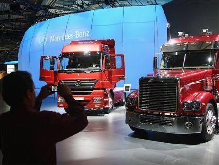 Truck maker Daimler signs agreement to return to Iran