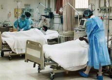 Bahrain nurses wear black ribbons in pay fight